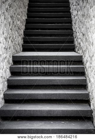 Narrow staircase with stone wall vintage filter