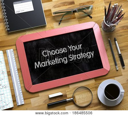 Small Chalkboard with Choose Your Marketing Strategy. Top View of Office Desk with Stationery and Red Small Chalkboard with Business Concept - Choose Your Marketing Strategy. 3d Rendering.