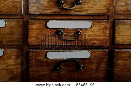 Vintage wooden drawer with inscriptions in old pharmacy, closeup