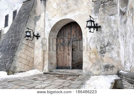 Doors in courtyard of old house in winter