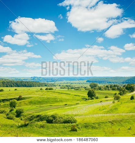 Rural scene white fluffy clouds. Fantastic and gorgeous day. Location place Ukraine, Europe. Wonderful summertime of wallpaper. Abstract seasonal background. Explore the world's beauty and wildlife.