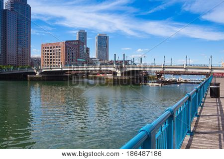 Boston Massachsetts USA - July 2 2016: Boston skyline and Seaport boulevard bridge.