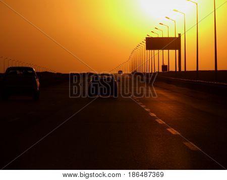 Tramonto sulla strada tra Il Cairo e Alessandria d'Egitto