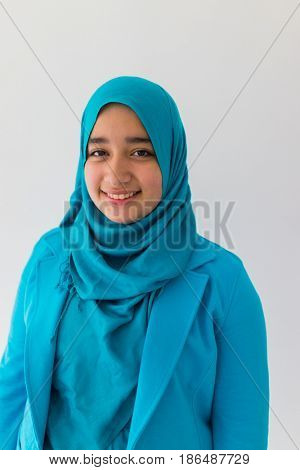 happy beatiful woman wearing nice blue islamic dress