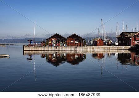The harbor for boats with petrol station on Oslofjord in Holmestrad, Norway.