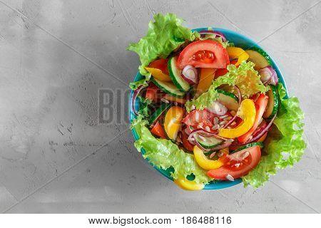 Fresh Summer Vegetable Salad In Blue Bowl