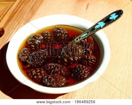 Jam made from small pine cones. Closeup. Siberian delicacy