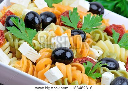 Fusilli with vegetable in a ceramic bowl close-up