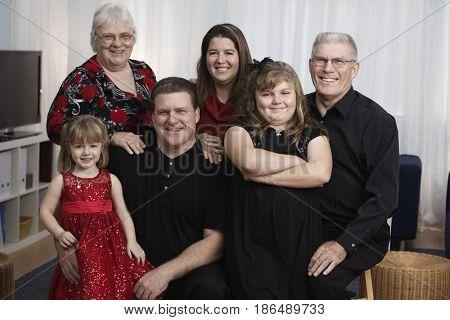 Smiling family in elegant clothing
