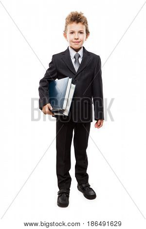 Handsome smiling child boy in business suit hand holding education reading books heap white isolated
