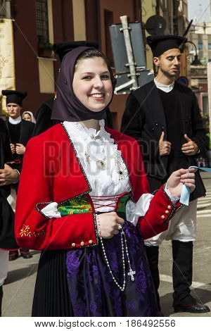 CAGLIARI, ITALY - MAY 1, 2013: 357 Religious procession of Sant'Efisio - portrait of a beautiful smiling woman dressing in traditional Sardinian costume - Sardinia
