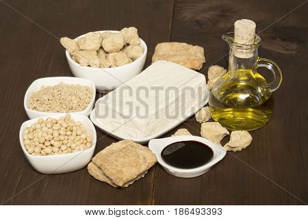 The various soy products on wooden background