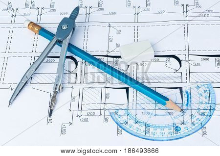 Angle Ruler, Pencil, Rubber and Caliper on Blueprint