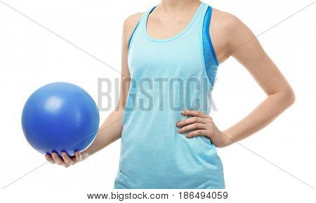 Woman with rubber ball on white background