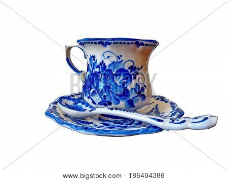 The cup with saucer and teaspoon on a white background. Things in Russian traditional Gzhel style. Closeup. Isolated on white.