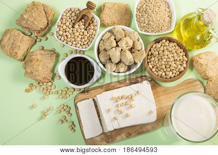 The various soy products on green background