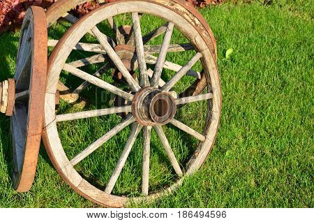 Old wooden wheel from the historic rural carriage,