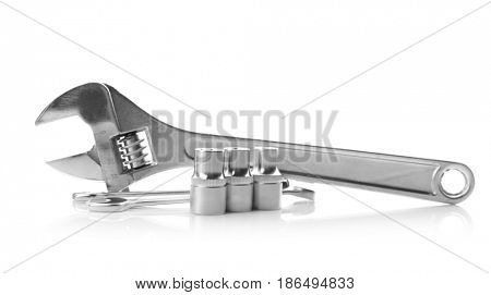 Screw and combination wrenches with hand sockets on white background
