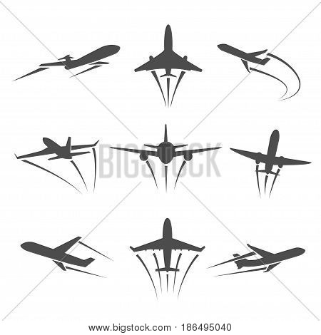 The dark silhouette of a plane taking off. Flying aircraft leaving behind a trail in the sky. Icons of planes in different positions on a white background.