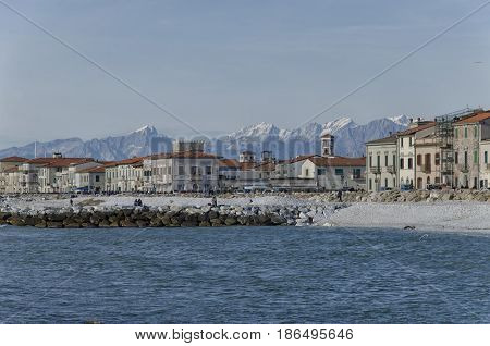 Beach of Marina di Pisa and Apuan Alps