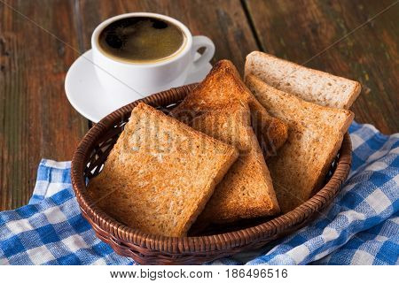 Breakfast background, toast and coffee on rustic wood. Espresso and bread