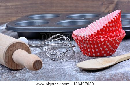 Kitchen utensils on wooden table close up