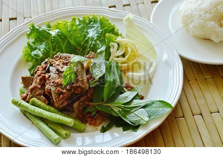 spicy minced pork and liver salad eat couple with sticky rice on dish