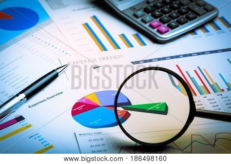 Magnifying glass calculator scrutinise scrutinize accuracy research scrutiny