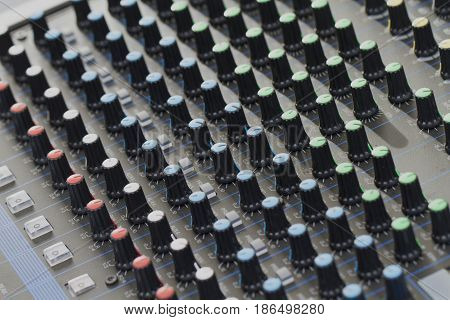 Close up image of sound mixer buttons