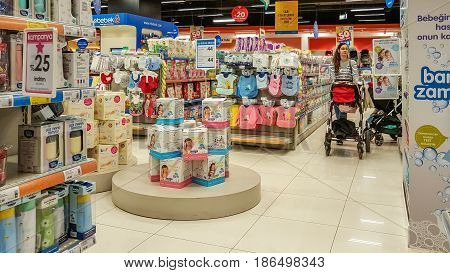 Eskisehir, Turkey - April 08, 2017: Female Customer With Baby Stroller Shopping In Baby Shop Store I