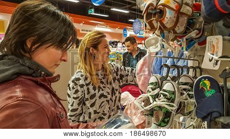 Eskisehir, Turkey - April 08, 2017: Shoppers Looking For Baby Products In Baby Shop Store. Man Pushi