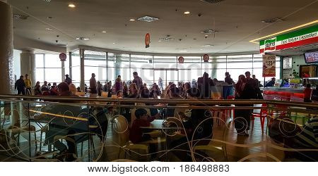 Eskisehir Turkey - April 08 2017: Crowded food court at shopping mall in Eskisehir. People resting and eating at Sbarro pizza place in a shopping mall.