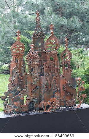 Donetsk Ukraine - May 09 2017: Iron sculpture of an Orthodox church in a park of forged figures