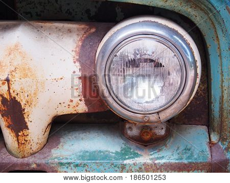 Close up retro headlight on vintage old car.