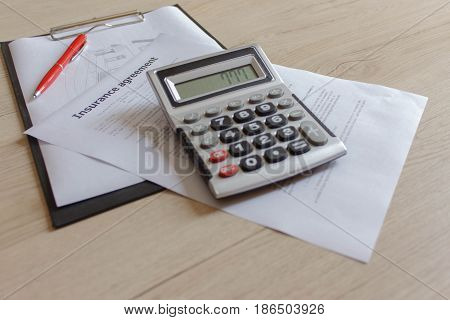 Renters insurance policy on a table. Insurance concept. Couple Filling Insurance Appication Form