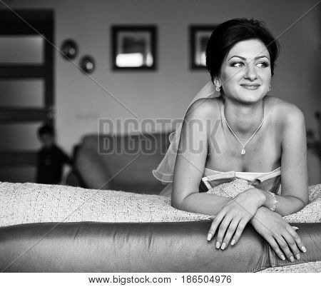 Hapy Dreamy Bride Lies On The Couch
