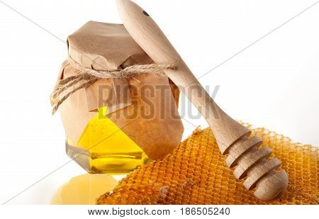 Honey Jar with Honey Dipper and Honeycomb Slice