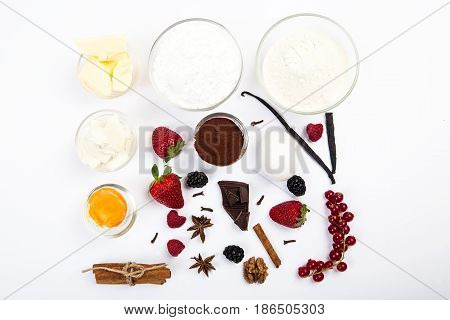 dessert ingredients and equipments on white table.