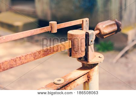 Ancient Platform Scales; Wood And Iron Weighing Machine. Selective Focus. Tinted Photograph.