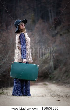 Pretty Girl With Vintage Case On A Dirtroad