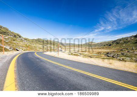 The Kosciusko Road near Perisher on a sunny autumn day in New South Wales, Australia