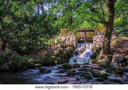 WATERFALL - Water dam and bridge in the urban garden