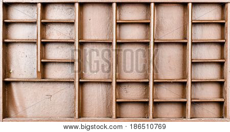 Empty wooden brown painted seed or letters or collectibles box with large number of shelves