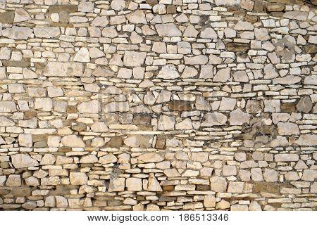 BERAT, ALBANIA - OCTOBER 01, 2016: Stone wall in Old town Berat, Albania on October 01, 2016.