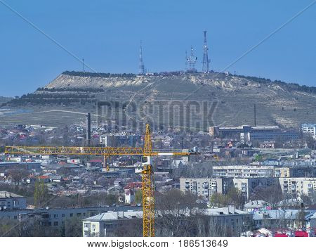 City and mountain with a TV tower. Crimea. Feodosia.