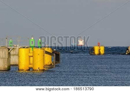 OUTPORT - Small merchant ship on the sea horizon