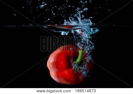Red Bell Sweet Pepper Droped Into Water