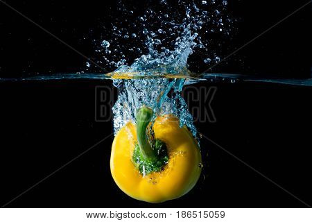 Yellow Bell Sweet Pepper Droped Into Water