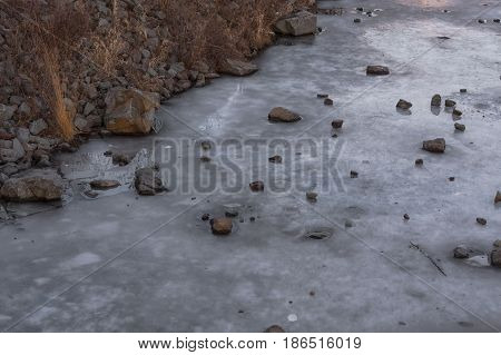Frozen water surface of a river. The river Ruhr in the city of Essen Kupferdreh.