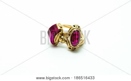 Old gold rings with purple stone (amethyst) isolated on white background.